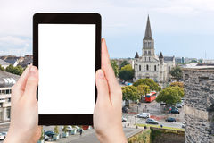 Tourist photographs of St Laud's Church in Angers. Travel concept - tourist photograph cityscape with St Laud's Church in Angers, France on tablet pc with cut Royalty Free Stock Image
