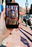 Tourist photographs of street in Boston Stock Images