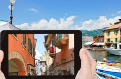 Tourist photographs of street in Malcesine town Royalty Free Stock Photo