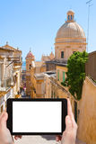 Tourist photographs of street in Noto town, Sicily Royalty Free Stock Image