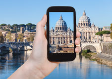 Tourist photographs Vatican basilica from Rome Royalty Free Stock Photography