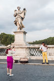 A tourist photographs the violinist.  Rome, Italy Stock Photos