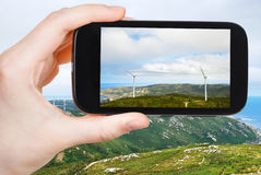 Tourist photographs of wind turbines in Galicia Stock Images