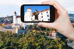 Tourist photos statue in Bratislava Hrad castle Royalty Free Stock Photography