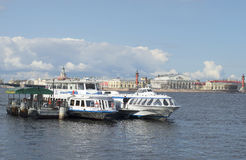 Tourist pier on the background of the spit of Vasilyevsky island. Saint Petersburg Royalty Free Stock Image