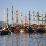 Tourist pirate sailing ships near the pier in the Mediterranean Sea. Port of Kemer, Turkey Stock Photography
