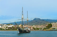 Tourist pirate ship anchored near beach Stock Image