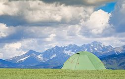 Tourist pitch a tent royalty free stock photography