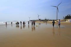 Tourist playing on the sandy beach Stock Photos