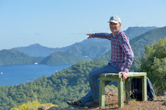 Tourist pointing away. Tourist on the bench pointing away to Marmaris bay Stock Images