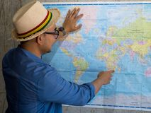 Tourist pointing at worldmap for next destination. Tourist pointing at worldmap for next destination, lifestyle concept Stock Photography
