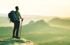 Tourist with poles in hand. Sunny spring landscape rocky summit royalty free stock photography