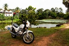 Tourist Police Motorcycle with lake in Angkor Wat, Cambodia stock image