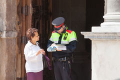 Tourist with Policeman Royalty Free Stock Images