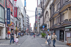 Tourist popular shopping scene in Osaka City at Dotonbori Namba area with signs and advertising billboards during daytime. Osaka, Japan - April 2016:  Tourist Royalty Free Stock Photo