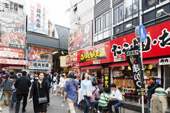 Tourist popular shopping scene in Osaka City at Dotonbori Namba area with signs and advertising billboards during daytime. Osaka, Japan - April 2016:  Tourist Stock Photo