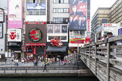Tourist popular shopping scene in Osaka City at Dotonbori Namba area with signs and advertising billboards during daytime. Osaka, Japan - April 2016:  Tourist Royalty Free Stock Images