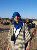 The tourist poses. In desert Sahara, Tunisia Royalty Free Stock Photos