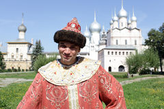 Tourist poses in regal clothes Royalty Free Stock Photo