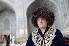 Tourist poses in uzbek clothes Royalty Free Stock Images