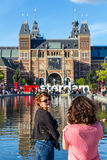 Tourist posing for the camera in Amsterdam Stock Images