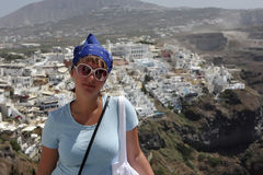 Tourist is posing in Fira Stock Images