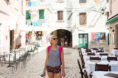 Tourist posing in front of empty restaurant Stock Photo