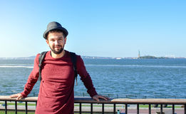 Tourist posing in front of Statue of Liberty in New York Stock Image