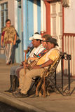 Tourist posing with locals in Salento Colombia. February 20, 2017 Salento, Colombia: it`s popular activity for tourists to pose with the locals for a photo stock photos