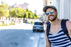 Tourist posing for pictures in Havana, Cuba Stock Photography