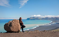 Tourist posing by the rock, Iceland Stock Images