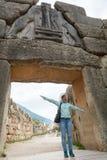 Tourist posing under famous Lion gate entrance. Stock Photos