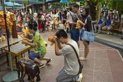 Tourist praying on Ratchaprasong Erawan shrine. Popular sight seeing in Bangkok Royalty Free Stock Photo