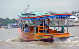 Tourist Private Sightseeing Boat on Chao Phraya River in Bangkok Stock Photo
