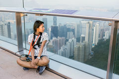 Tourist on the prospect of Hong Kong. Woman resting on the prospect of Hong Kong Stock Photo
