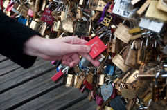 Tourist put a lovepadlock  in the bridge of arts in paris Royalty Free Stock Photo