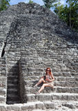 The tourist  in pyramid ruins Mexico. Royalty Free Stock Images