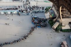 Tourist queue under the Eiffel Tower stock photography