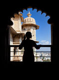 Tourist in Rajasthan City Palace. Woman silhouette on the balcony in City Palace museum of Udaipur, Rajasthan, India Stock Images