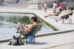 Tourist reading and taking sun Royalty Free Stock Photography