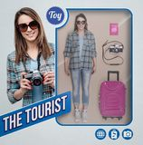 The tourist realistic doll. Female tourist realistic doll with toy see through packaging, accessories and smiling character holding a camera stock photography