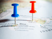 Tourist. Red and blue pushpins showing destination points on a map Royalty Free Stock Images