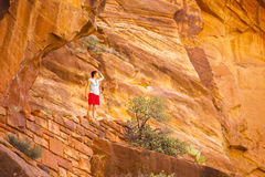 Tourist among red rocks in Zion National Park Royalty Free Stock Photography