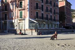 Tourist relaxing at Laigueglia beach, Riviera dei Fiori, Savona, Liguria, Italy stock image