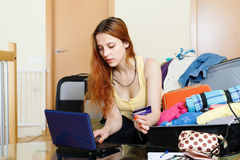 Tourist  reserving hotel online in the internet Royalty Free Stock Photo