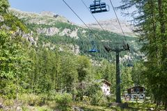 Tourist resort in the Alps. Chairlift in Macugnaga, Italy royalty free stock photography