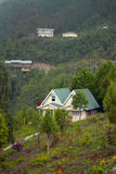 A tourist resort at hill top. A tourist resort made by wood at hill top in Rishap, near Kalimpong at Darjeeling.Rishap small village on the hill top can be Stock Image