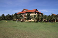 Tourist resort hotel in Vietnam. Scenic view of a luxurious tourist resort hotel with landscaped gardens and palm trees in Vietnam Royalty Free Stock Image