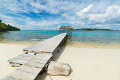 Tourist resort and jetty on scenic tropical beach in Indonesia Stock Photo