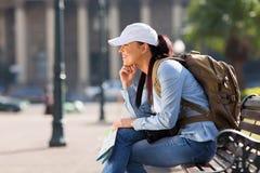 Tourist resting on bench Stock Photo